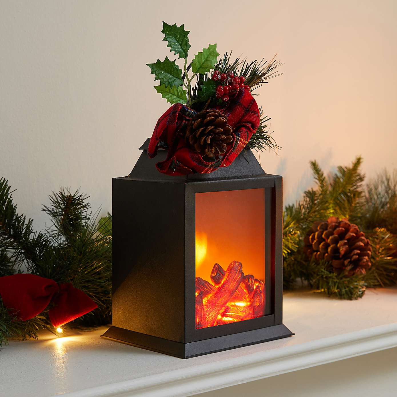 Black Fireplace Lantern with Holly and Berries £12 on Dunelm